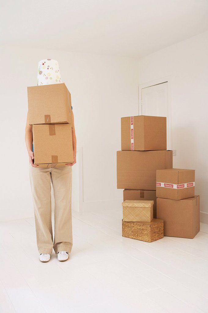 Person carrying moving boxes : Stock Photo