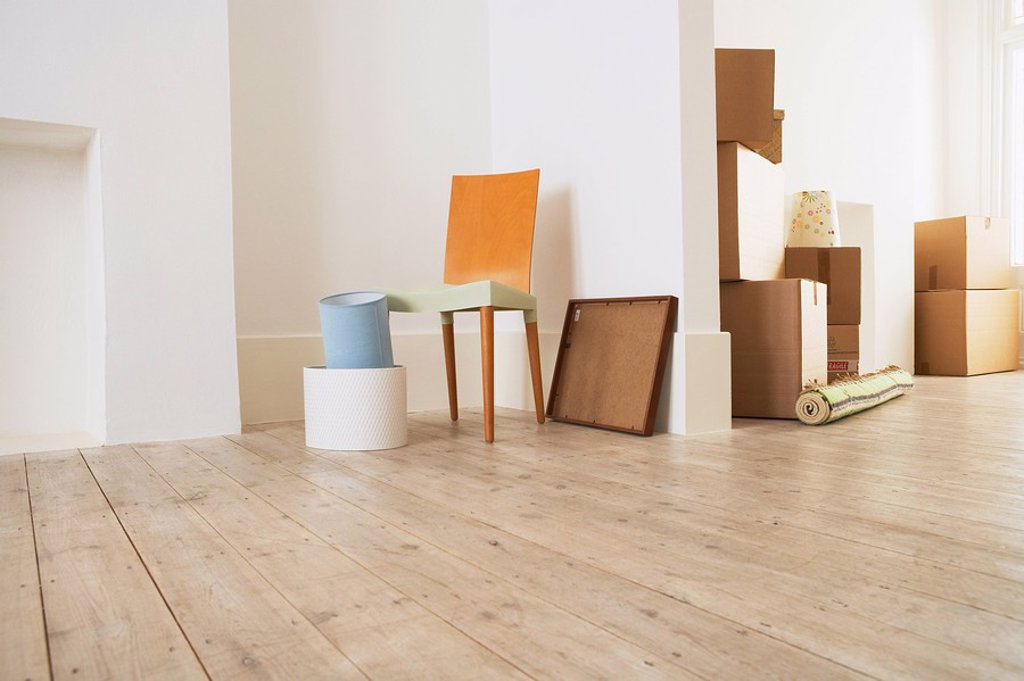 Furniture and Cardboard Boxes in New House : Stock Photo