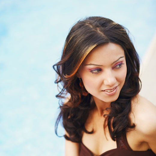 Stock Photo: 1657R-10911 Close-up of a young woman at the poolside