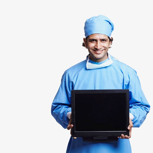 Stock Photo: 1657R-11090 Portrait of a male doctor wearing surgical scrubs and holding a laptop