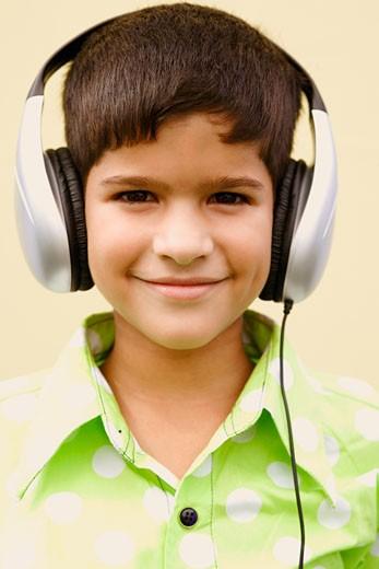 Stock Photo: 1657R-12015 Portrait of a boy wearing headphones and smirking