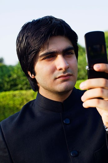 Close-up of a young man using a mobile phone : Stock Photo