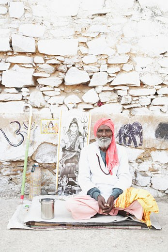 Stock Photo: 1657R-12827 Portrait of a sadhu sitting on a mat