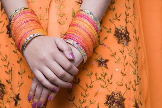 Stock Photo: 1657R-13097 Close-up of bangles on a woman's wrists