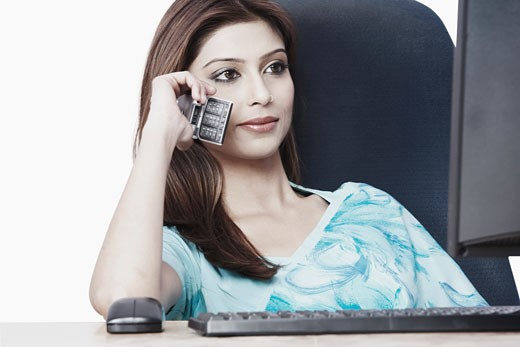 Close-up of a businesswoman talking on a mobile phone : Stock Photo
