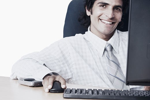 Stock Photo: 1657R-1319 Portrait of a businessman using a computer