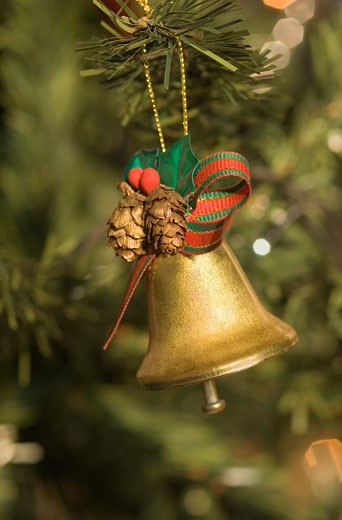 Close-up of a Christmas bell hanging on a Christmas tree : Stock Photo