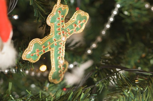 Stock Photo: 1657R-13315 Close-up of a cross hanging on a Christmas tree