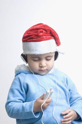 Close-up of a boy listening to an MP3 player : Stock Photo