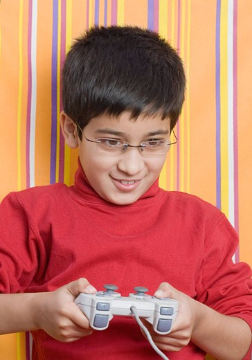 Stock Photo: 1657R-13845 Close-up of a boy playing video game