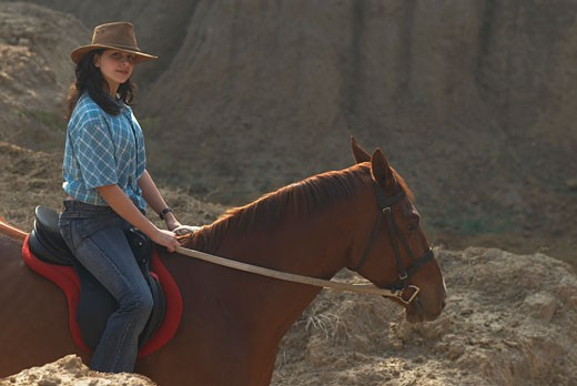 Stock Photo: 1657R-14032 Portrait of a teenage girl riding a horse