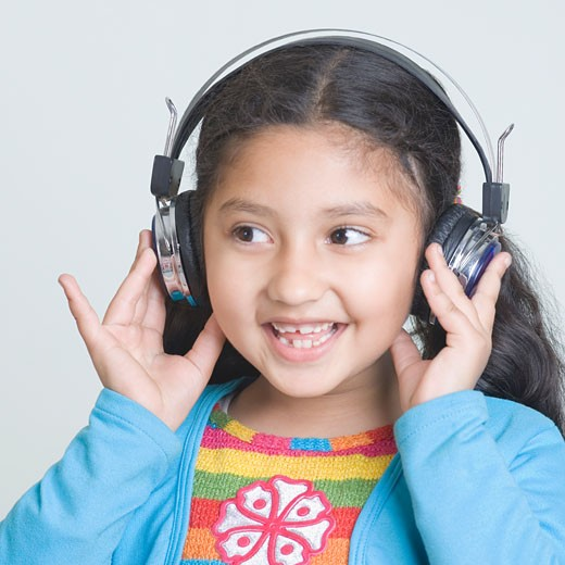 Stock Photo: 1657R-14551 Close-up of a girl listening to music and smiling