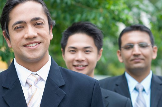 Portrait of three businessmen in a row : Stock Photo