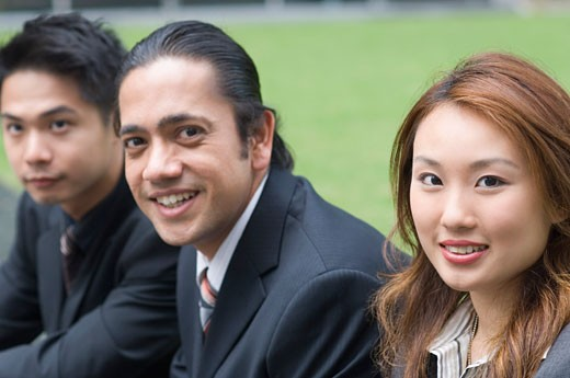 Stock Photo: 1657R-14926 Portrait of two businessmen and a businesswoman sitting together