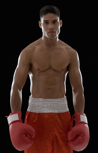 Stock Photo: 1657R-15229 Portrait of a boxer wearing boxing gloves