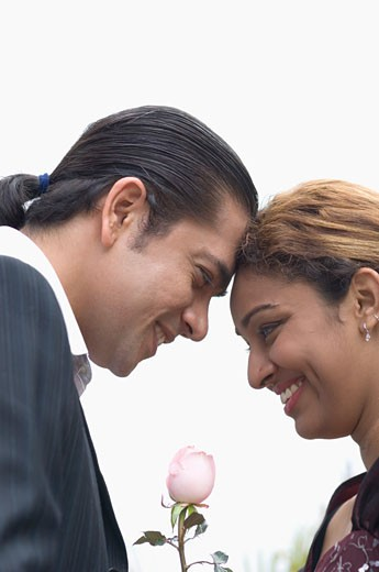 Side profile of a couple with face to face and smiling : Stock Photo