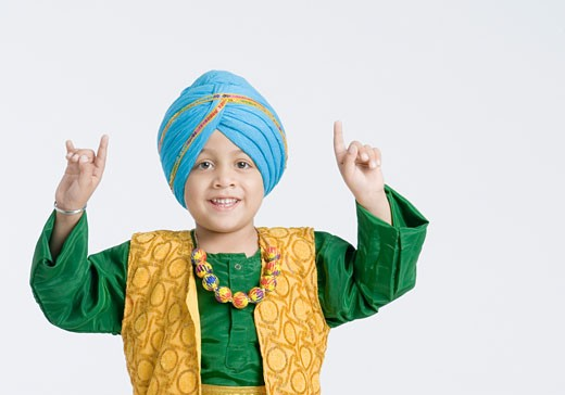 Portrait of a boy doing bhangra and smiling  : Stock Photo