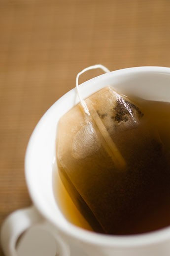 Close-up of a teabag in a cup of tea : Stock Photo