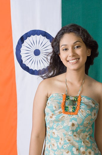 Stock Photo: 1657R-17501 Portrait of a young woman standing in front of an Indian flag