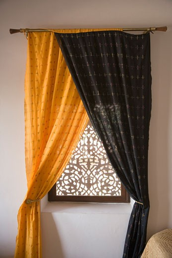 Curtains hanging on a window in a hotel room : Stock Photo