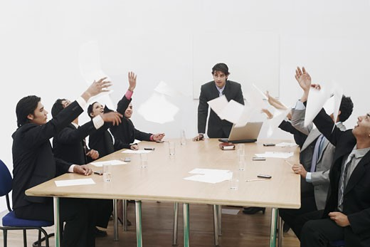 Stock Photo: 1657R-1826 Group of business executives throwing sheets of paper in a meeting