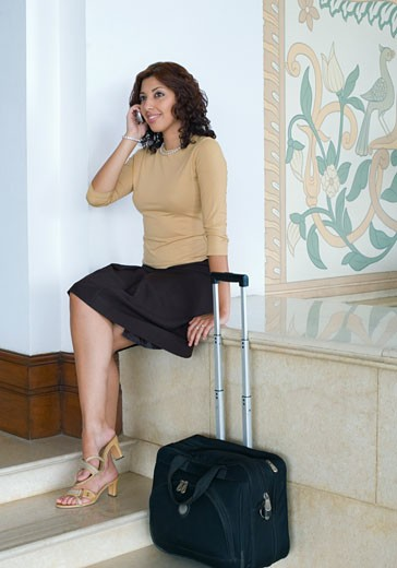 Stock Photo: 1657R-18803 Businesswoman talking on a mobile phone and smiling