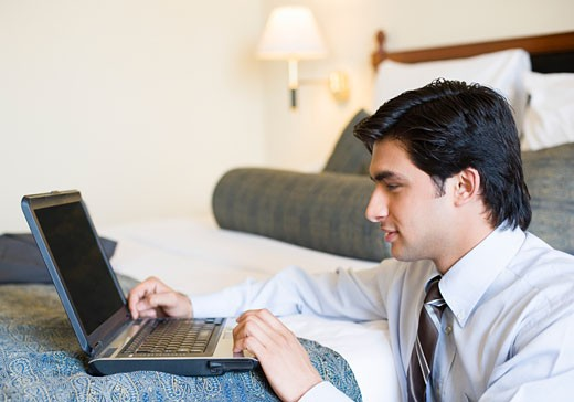 Close-up of a businessman using a laptop : Stock Photo