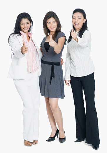 Stock Photo: 1657R-19894 Portrait of three young women showing their thumbs up and smiling