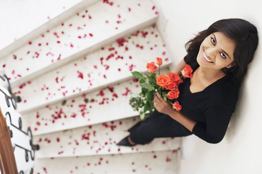 High angle view of a young woman holding a bouquet of flowers : Stock Photo
