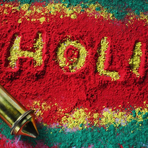 High angle view of a squirt gun on a rangoli : Stock Photo