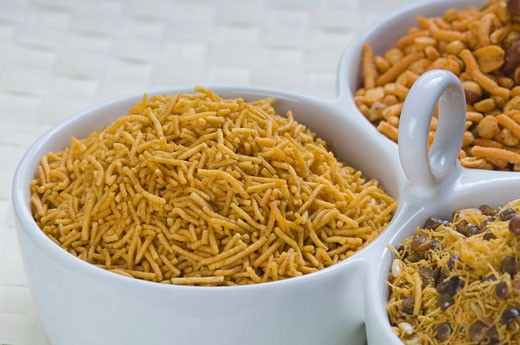 Close-up of various type of snacks in bowls : Stock Photo