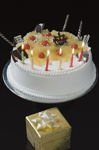 Stock Photo: 1657R-21613 Close-up of lit candles on a birthday cake