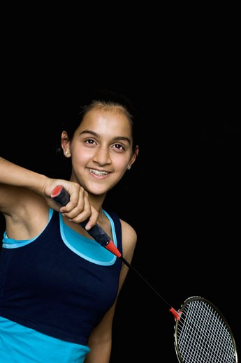 Stock Photo: 1657R-21771 Teenage girl holding a badminton racket and smiling