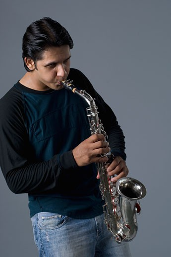 Stock Photo: 1657R-22083 Young man playing a trumpet