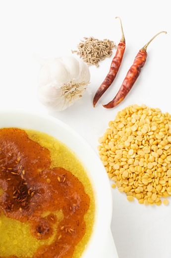 Close-up of lentil soup served in a bowl with its ingredients : Stock Photo