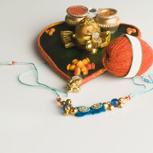 Stock Photo: 1657R-22720 Close-up of a rakhi with a rakhi thali