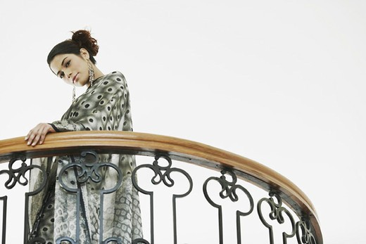 Stock Photo: 1657R-23139 Low angle view of a young woman standing in the balcony