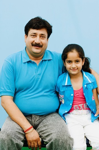 Portrait of a mature man with her daughter grinning : Stock Photo