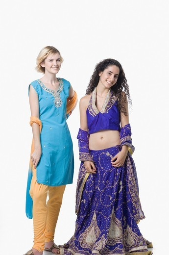 Stock Photo: 1657R-29332 Portrait of two young women standing together in traditional clothing and smiling