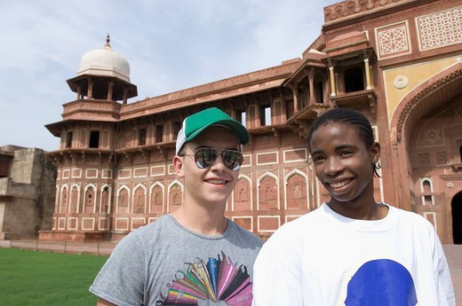 Portrait of two young men smiling, Taj Mahal, Agra, Uttar Pradesh, India : Stock Photo