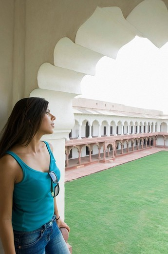Young woman standing in a mausoleum, Taj Mahal, Agra, Uttar Pradesh, India : Stock Photo