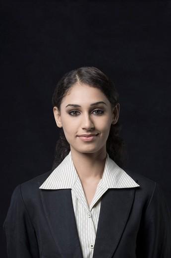 Portrait of a businesswoman smirking : Stock Photo