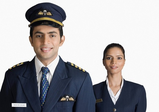 Stock Photo: 1657R-31468 Portrait of a pilot with an air hostess