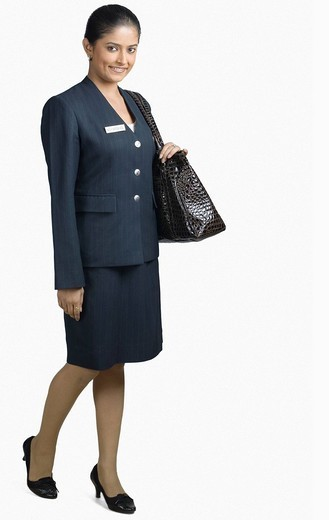 Portrait of an air hostess smiling : Stock Photo