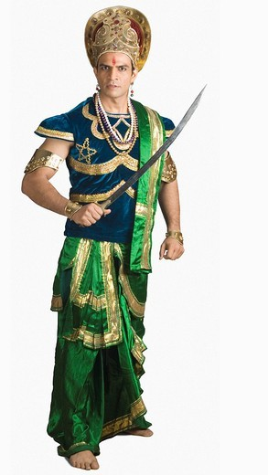 Portrait of a man dressed_up as a mythological character holding a sword : Stock Photo