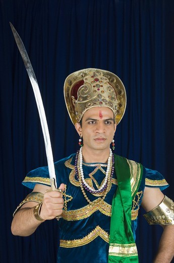Stock Photo: 1657R-31534 Close_up of a man dressed_up as a mythological character holding a sword