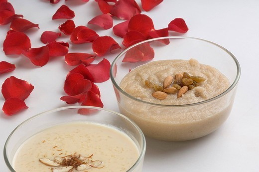Stock Photo: 1657R-31954 Close_up of rice pudding and halva in bowls