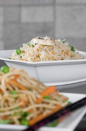 Close_up of noodles and fried rice in bowls : Stock Photo
