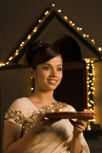 Woman holding religious offering and smiling : Stock Photo