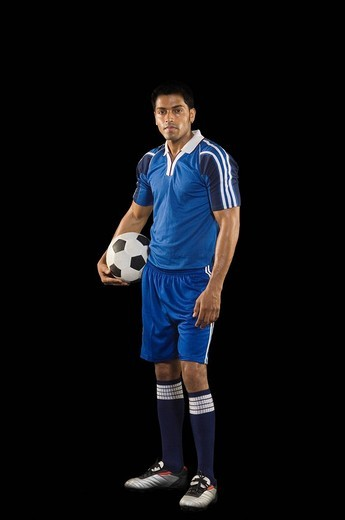 Stock Photo: 1657R-32309 Portrait of a man holding a soccer ball